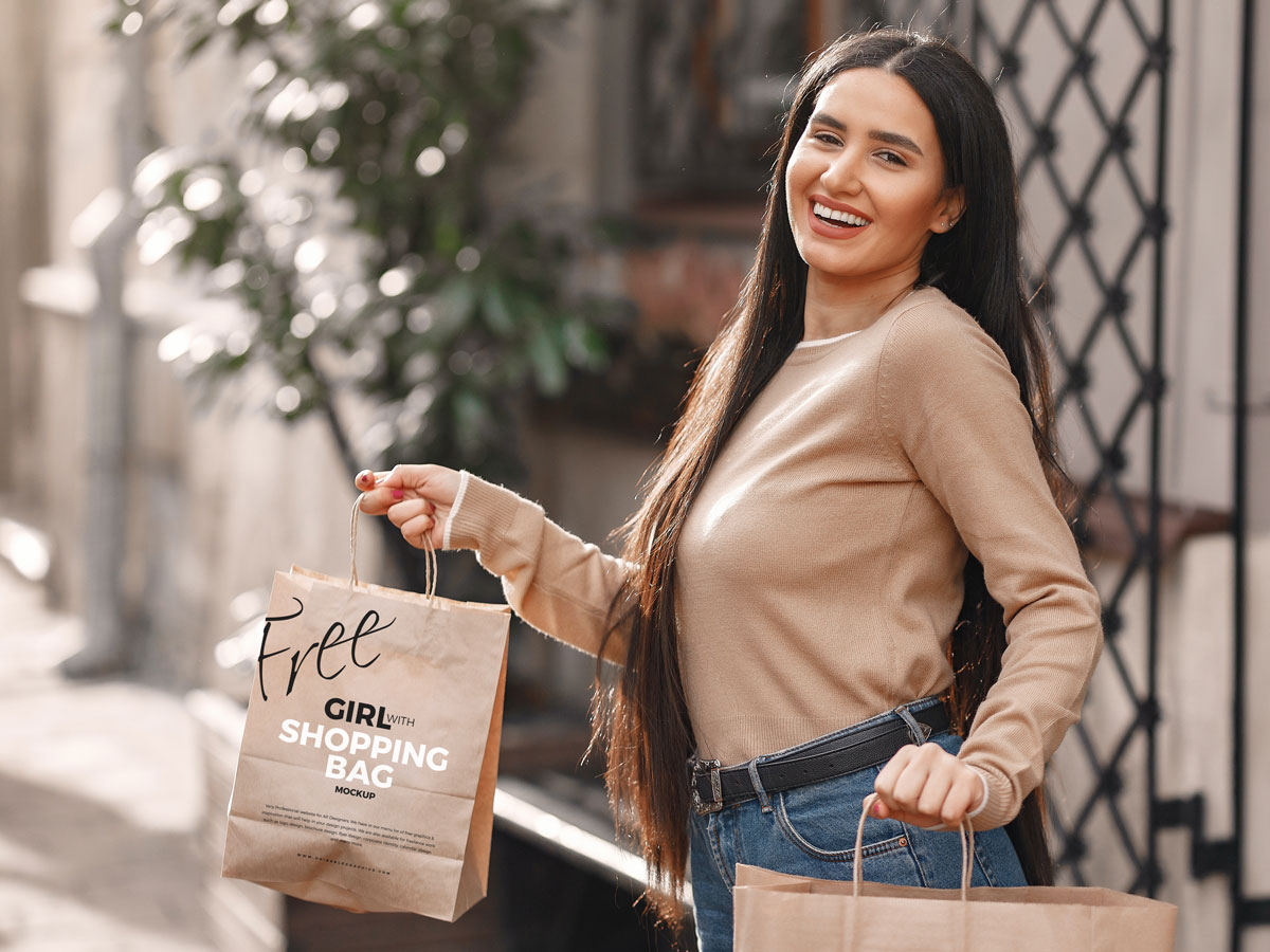 Girl-With-Shopping-Bag-MockUp-Freebie-on-Antique-Wooden-Background
