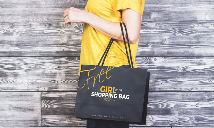 Girl-With-Shopping-Bag-MockUp-Freebie-on-Antique-Wooden-Background-2017