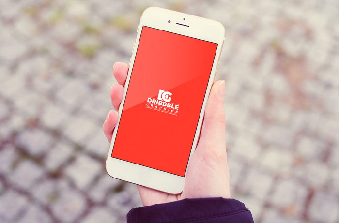 Free-Outdoor-Girl-Holding-iPhone-MockUp