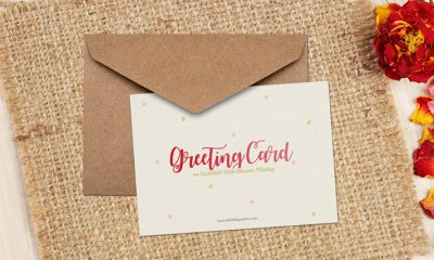 Free-Greeting-Card-on-Sackcloth-With-Flowers-Mockup-600