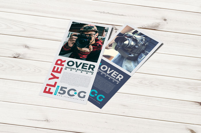 Free-Flyer-Over-Wooden-Background-Mockup