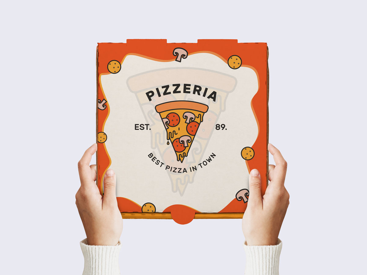 Free-PSD-Pizza-Boy-Holding-Pizza-Packaging-Mockup
