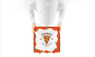 Free-Pizza-Boy-Holding-Pizza-Packaging-Mockup-PSD-300
