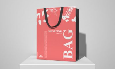 Free-Shopping-Bag-on-White-Podium-Mockup-300