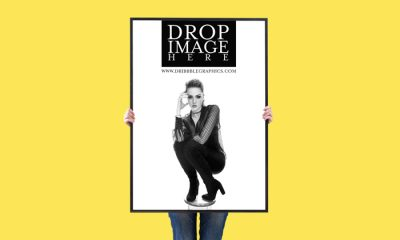 Free-Woman-Showing-Vertical-Poster-Mockup-For-Advertisement-2018-Preview-Image
